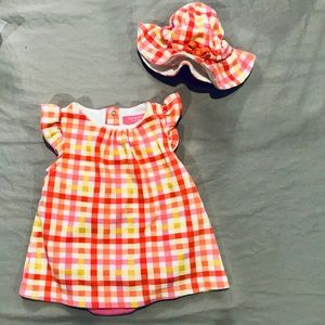 Brightly colored baby romper + matching hat
